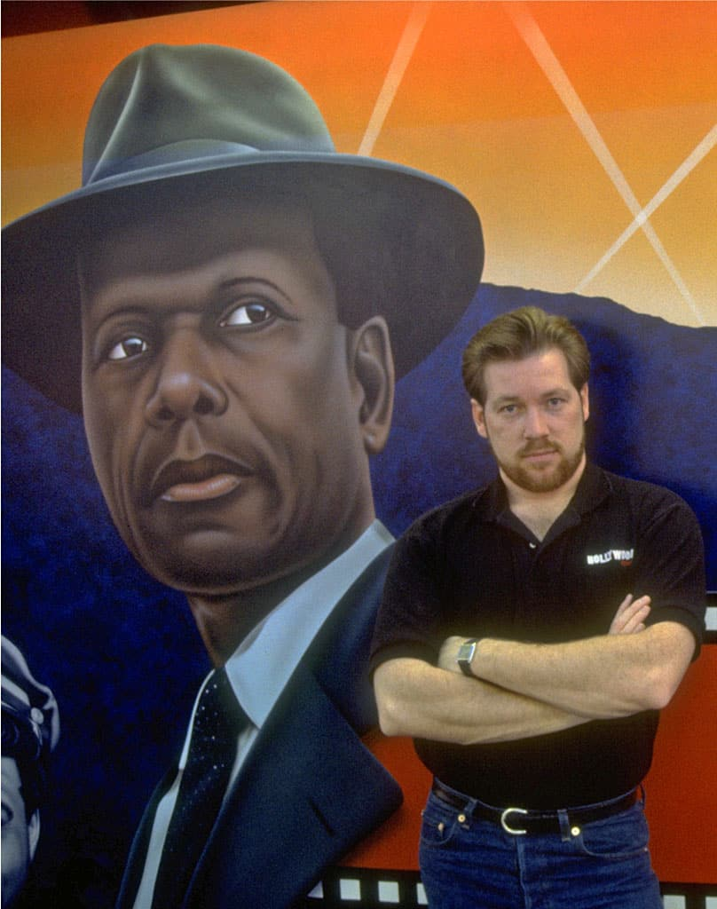 A.D. Cook with Mr. Tibbs wall mural at Hollywood video, Lake Oswego, OR 1991