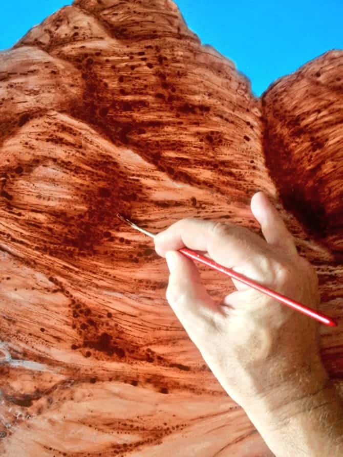 Fast Forward by A.D. Cook - painting mountains by hand.