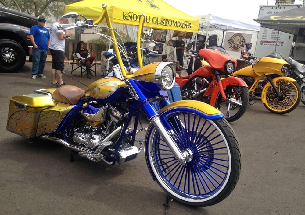 Yellow and blue custom bagger at AZ Bike Week 2014, Cave Creek, AZ