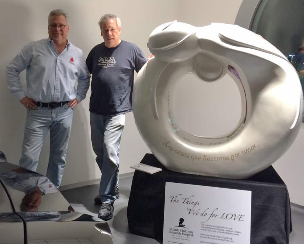 St. jude statue at Lamborghini Las Vegas Tom Brazill and A.D. Cook