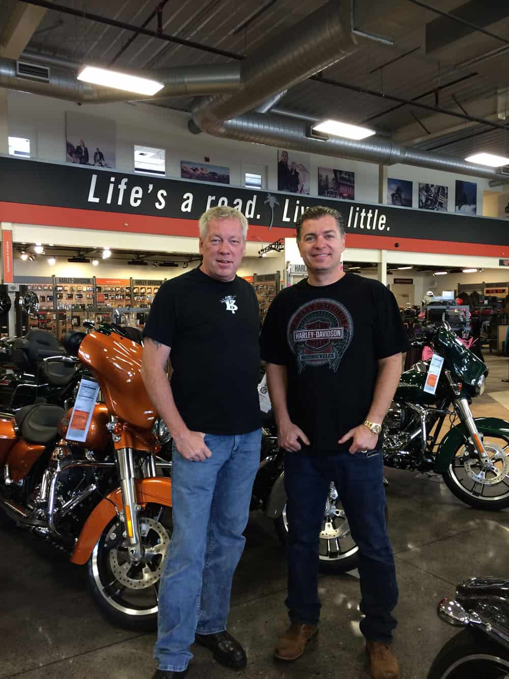 Artist A.D. Cook & collector Ed Wallace at Destination Harley-Davidson