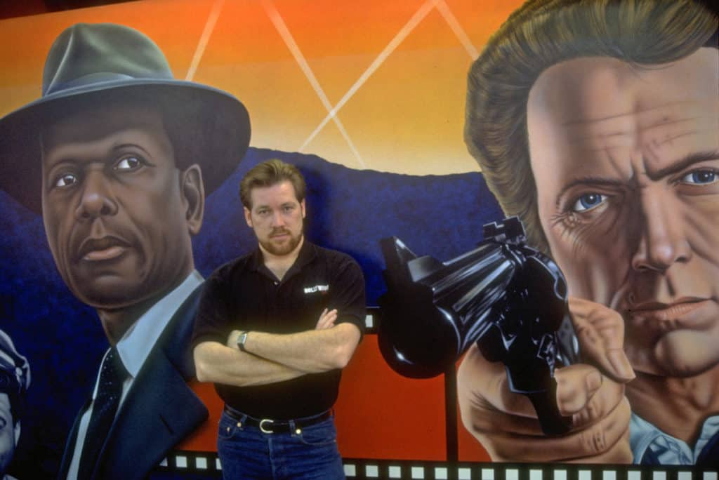 Artist A.D. Cook with Mr. Tibbs and Dirty Harry Hollywood Video mural