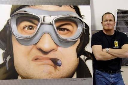 Artist Steve Driscoll with Belushi painting